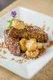 sautéed bananas served on grilled home made banana walnut pound cake with caramel sauce .jpg