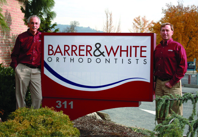 barrer and white orthodontists sign for web.jpg
